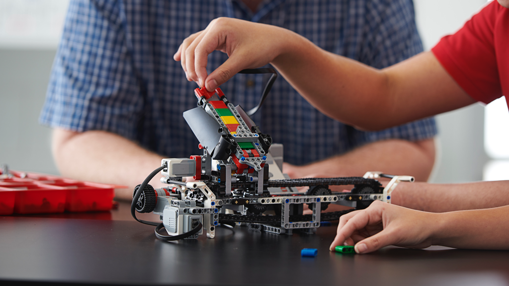 Close-up of students learning problem-solving and critical thinking with LEGO® MINDSTORMS® Education EV3.
