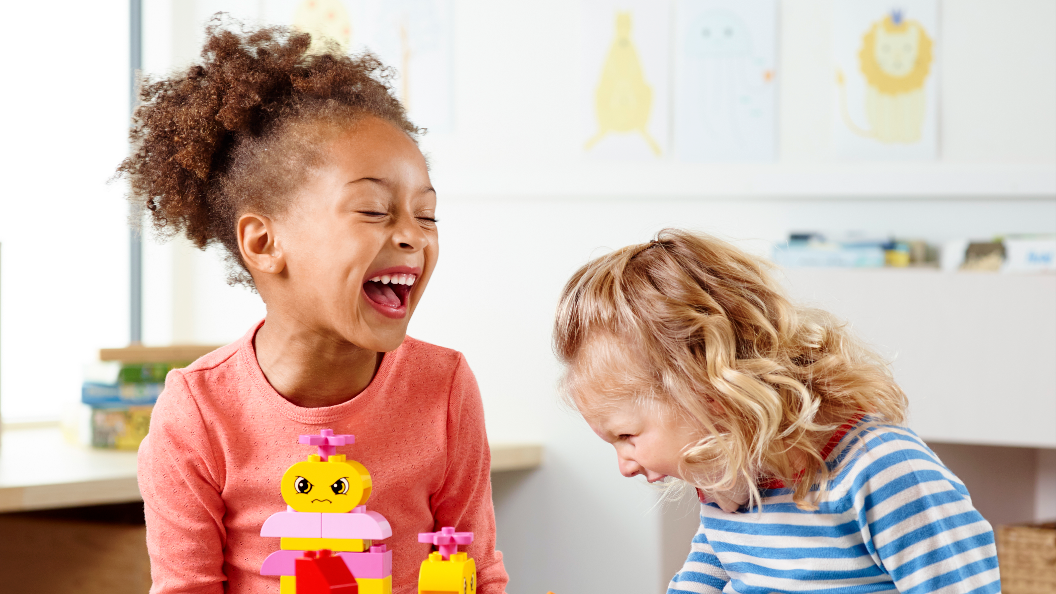 "Two preschool children playing with Build Me ""Emotions"" by LEGO® Education, developing their emotional skills"