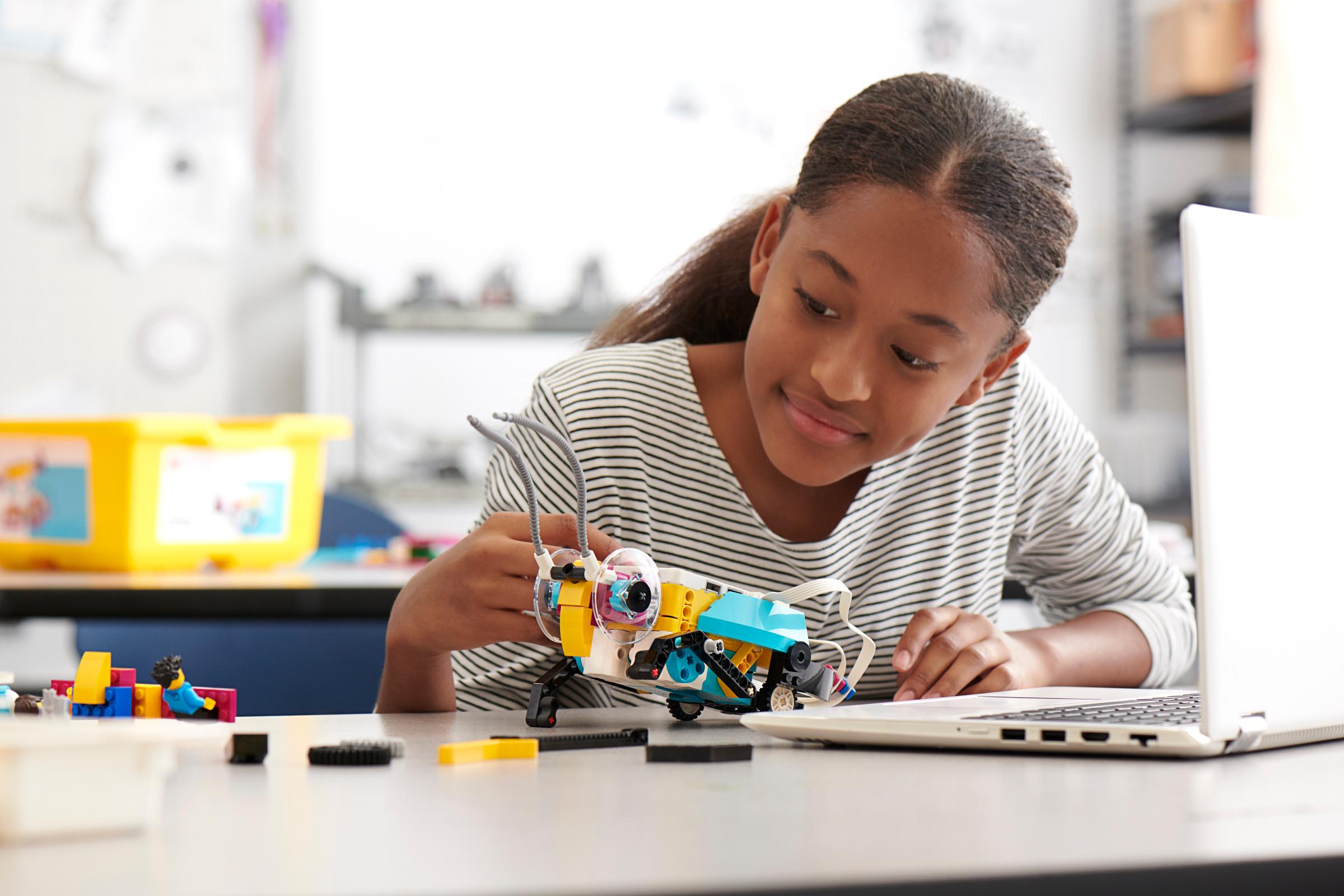 Middle school student building the LEGO® Education SPIKE™ Prime grasshopper model