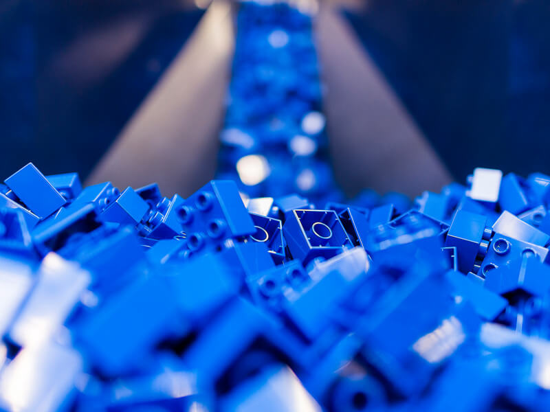 Blue LEGO bricks on a production line