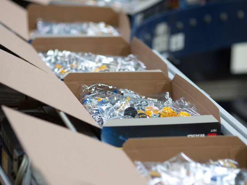Boxes of LEGO on a packaging line