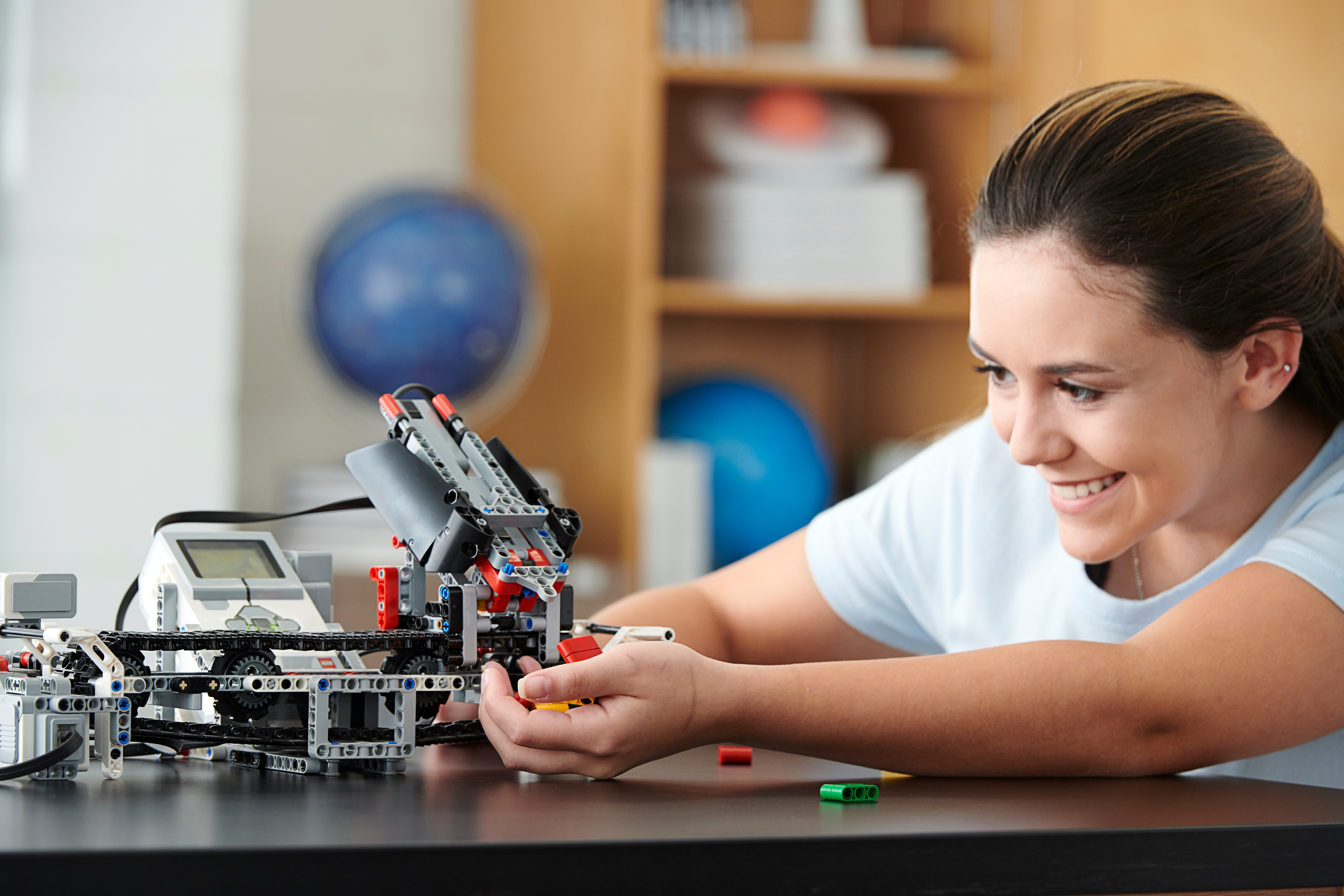 High school student tests the LEGO Education MINDSTORMS EV3 Color Sorter model in class