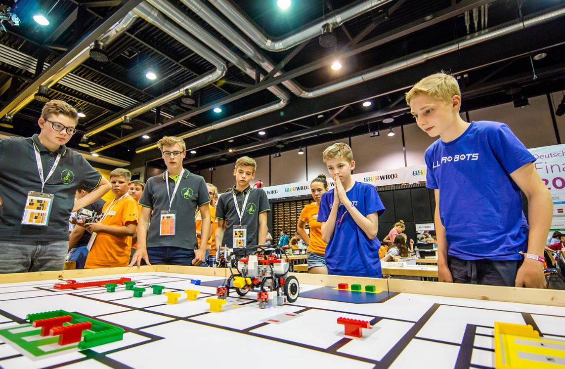Students participating in World Robot Olympiad, developing their confidence to learn and understand complex concepts.
